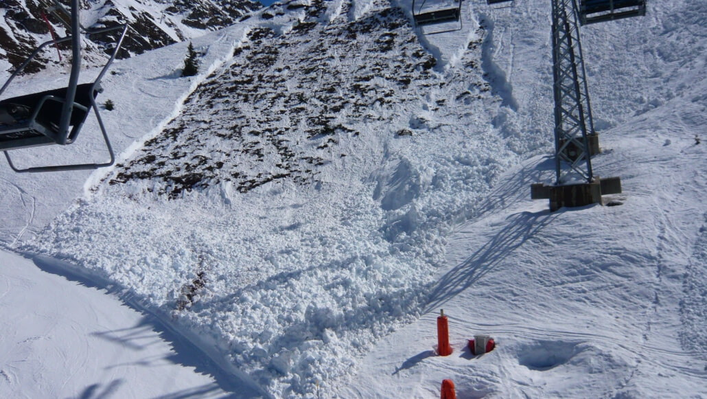 wet snow avalanche falls across the piste in Verbier