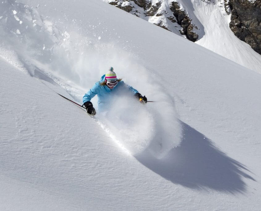 Skiing off piste powder snow in Verbier