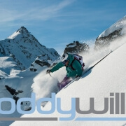 New Logo overlaid on photo of Roddy Willis skiing in Verbier